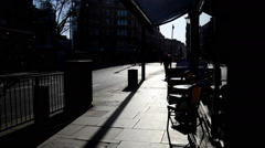 London. Coffee Shop terrace against the light. Charing Cross Road Timelapse Stock Footage