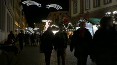 People walking on the Christmas market streets in Heidelberg Stock Footage