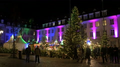 Tourists walking on the street at the Christmas market in Heidelberg Stock Footage