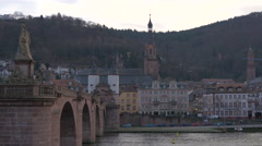 The Old Bridge and people walking and cars driving on the street,Heidelberg Stock Footage