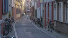 View of a beautiful small street with parked bikes in Heidelberg - stock footage