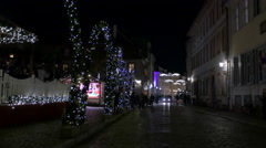 People walking and cars driving on a street, on Christmas in Heidelberg Stock Footage