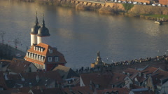View of many tourists walking on the Old Bridge in Heidelberg Stock Footage