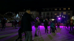 People ice skating at the Christmas market in Heidelberg Stock Footage