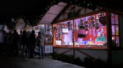Tourists gathered near a street stall at the Christmas market in Heidelberg Stock Footage
