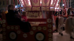 Kids in a merry-go-round at the Christmas market in Heidelberg Stock Footage