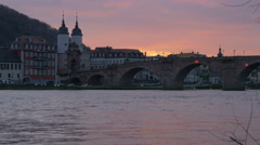 Beautiful view of the Old Bridge over the river at sunset in Heidelberg Stock Footage