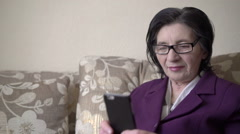 Business woman in her 70s and lifestyle technology. - stock footage