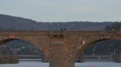 People walking and standing on the Old Bridge in Heidelberg Stock Footage