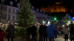 Tourists walking around the Christmas tree in Karlplatz in Heidelberg Stock Footage