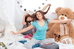 Two amusing cheerful sisters having fun Stock Photos