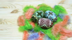 Easter eggs from beads on feather nest Stock Footage