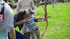Stock Video Footage of Mother teaches child archery