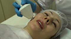 Rf-lifting procedure on a woman's face - stock footage