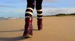 Little girl walks along shore of Baltic Sea Stock Footage