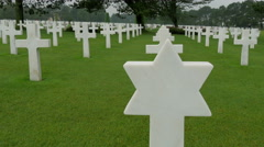 A star signed cross in Normandy Cemetery - stock footage