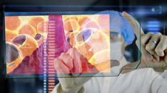 Doctor with futuristic hud screen tablet.  Fat cells. Medical concept future Stock Footage