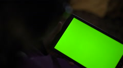 A blank tablet PC in landscape orientation with a green screenin hands. Slowly Stock Footage