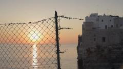 Broken fence dawn sun sea timelapse Stock Footage