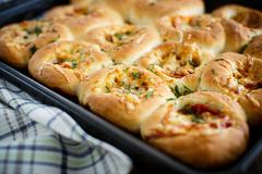 mini pizzas baked stuffed with cheese - stock photo