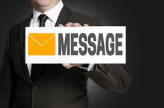 message sign is held by businessman - stock photo