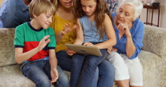 Multi generation family using tablet - stock footage