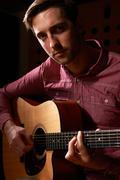 Man Playing Acoustic Guitar In Recording Studio Stock Photos