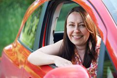 Portrait Of Mature Female Driver In Car Stock Photos