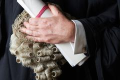 Close Up Of Barrister Holding Wig And Brief - stock photo