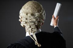 Lawyer Making Speech In Court Stock Photos