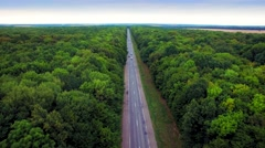 Aerial view of the road through green forest. - stock footage