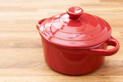 Red Casserole Dish On Wooden Surface - stock photo