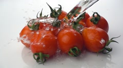 Tomatoes with water splash. - stock footage