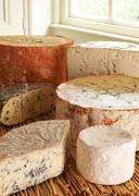 Selection Of Blue Cheeses On Display In Delicatessen - stock photo