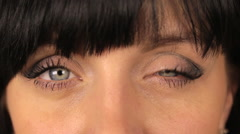 Girl winks with both eyes. makro, close up Stock Footage