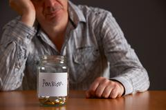 Depressed Man Looking At Empty Jar Labelled Pension Stock Photos