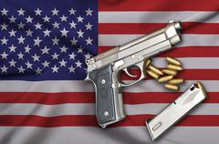 USA Gun Laws flag with pistol gun and bullet Stock Photos