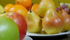Dolly shot on left, from pears to apples, fresh fruits extreme close up Stock Footage