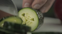 Cut Thin Slices of Cucumber in Restaurant Stock Footage
