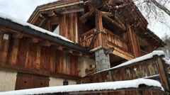 Chalet made of wood and stone in the Alps Stock Footage