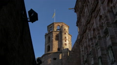 Octagonal tower in Heidelberg Castle near a building filled with sculptures - stock footage