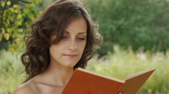 Portrait of beautiful woman holding book Stock Footage