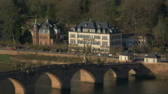 People walking on Alte Brucke over Neckar River in Heidelberg Stock Footage