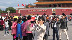 Massive crowds take pictures at Tiananmen Square in Beijing, China Stock Footage