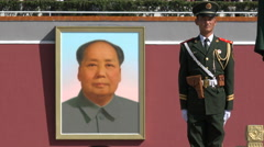 Mao Zedong portrait, soldier standing guard at Tiananmen Square, Beijing, China - stock footage