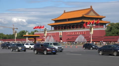 Traffic drives past Forbidden City entrance, contrast in Beijing, China Stock Footage
