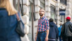 Hipster man with eyeglasses shopping in streets of London Kuvituskuvat