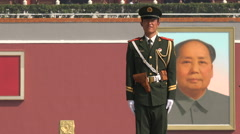Uniformed soldier standing guard, Mao Zedong portrait, Beijing, China Stock Footage