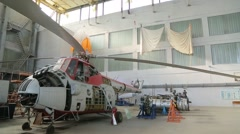 Disassembled helicopter and engine in the hangar Stock Footage