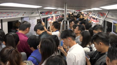 Busy commuter subway, passengers travel during rush hour in Beijing, China Stock Footage